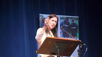 Wendy on stage speaking