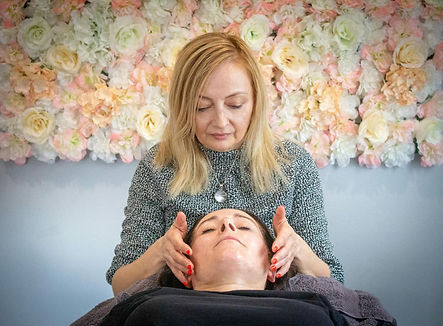Patsy giving a treatment to a client