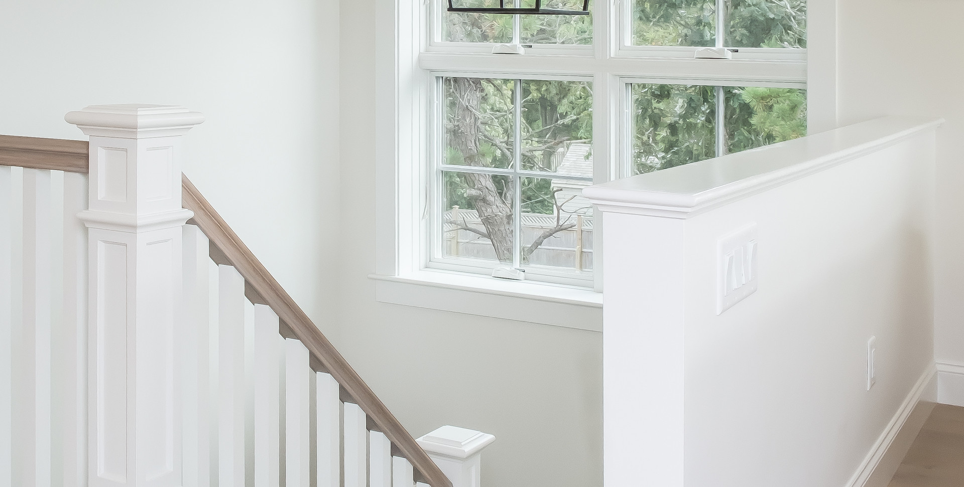 Bayberry Eastham, MA New Construction custom stairwell and light