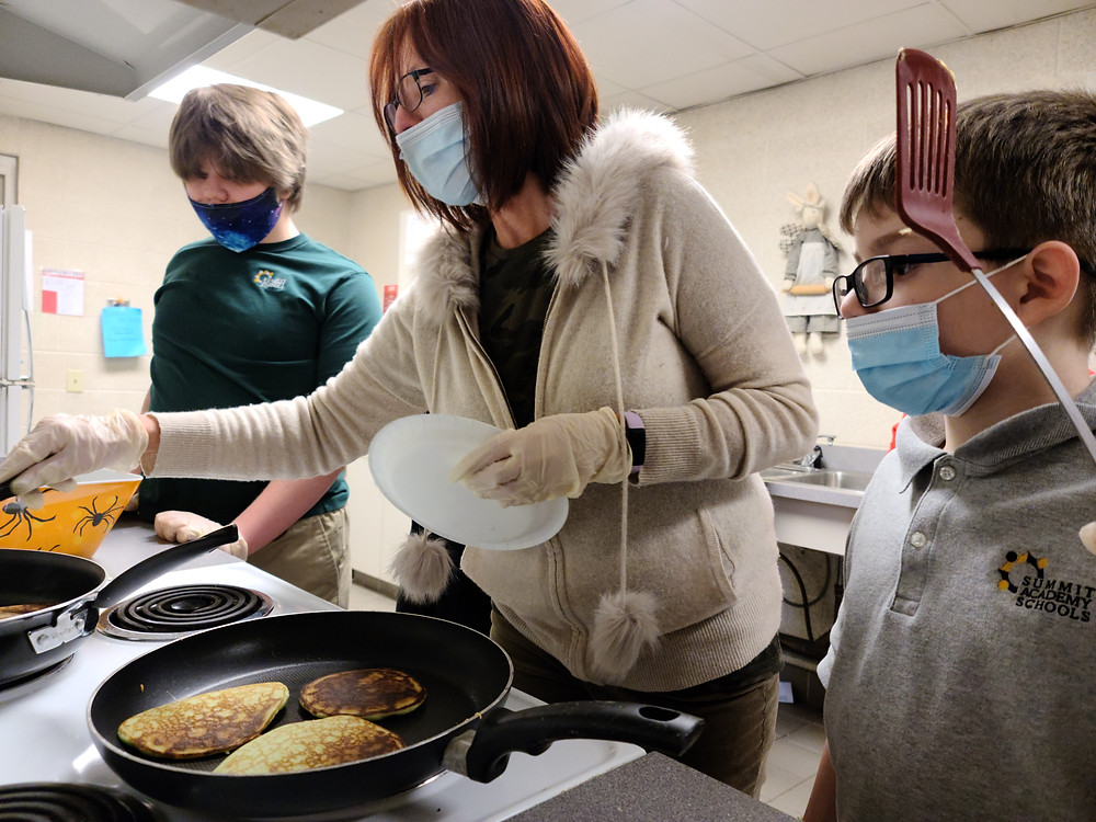 Summit Students Learn How to Make Pancakes