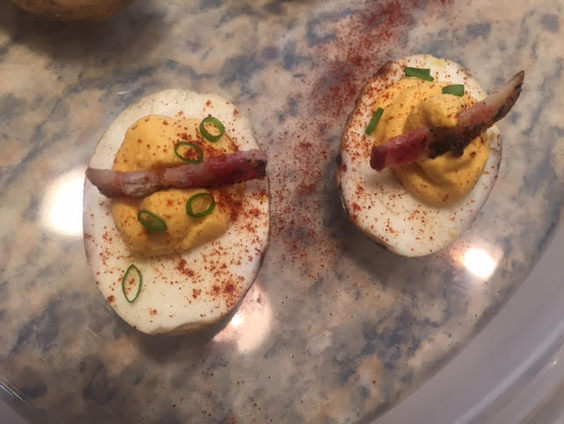 Smoked sririacha deviled eggs