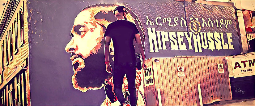 Abel Meri at Nipsey Hussle Mural in Washington, DC