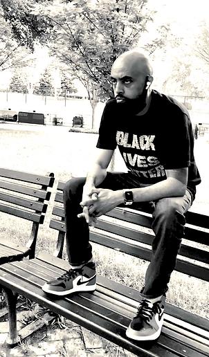 Abel Meri on DC park bench.