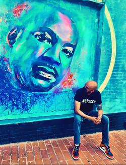 Abel Meri at MLK mural in Anacostia DC