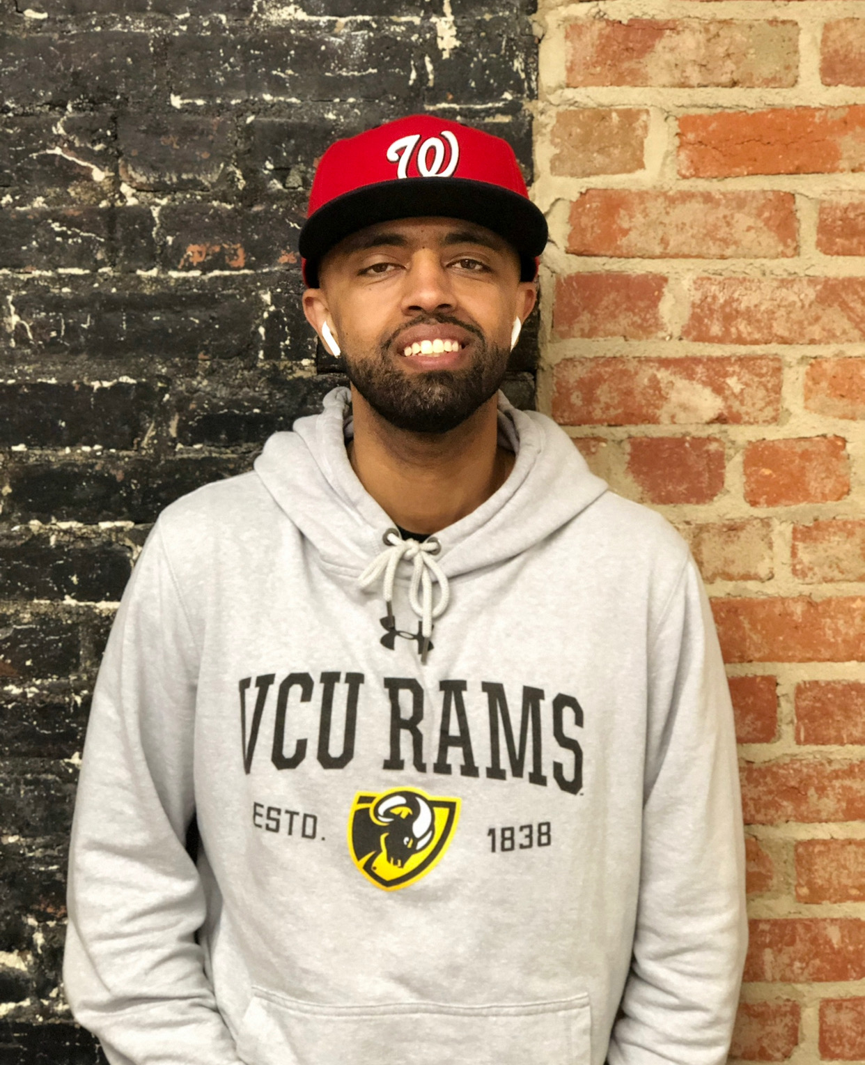 Abel Meri in Nats cap and VCU hoodie.
