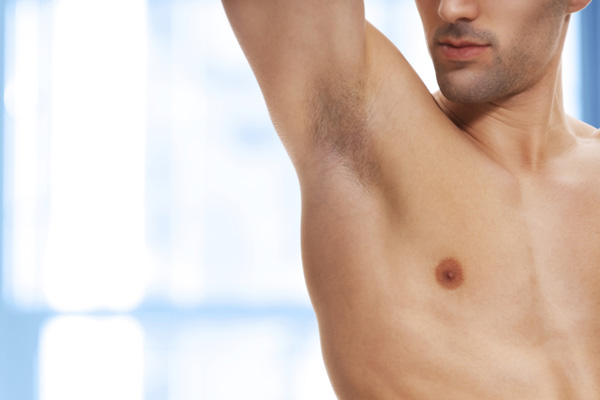 Some guys prefer to keep under arm hair trimmed short while others have it completely waxed off. (Photo; sunemotion, iStock, 360, Getty Images)