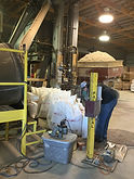 Hegg Mill Employee bagging feed
