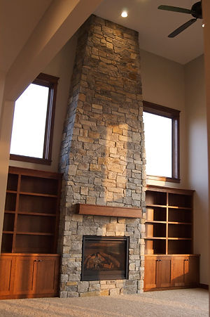 large stone fireplace designed and built by maplewood custom homes rochester mn