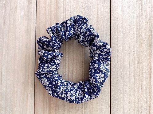 Coletero flores azules