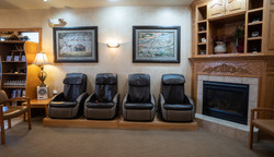 Reception area featuring massage chairs