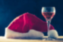 glass-wine-with-santa-hat-wooden-table-b