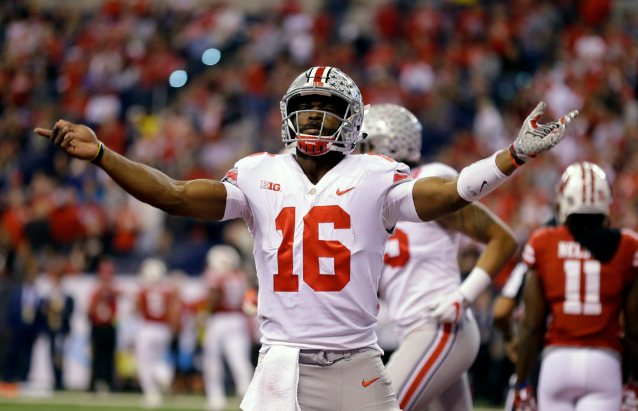 Ohio State quarterback J.T. Barrett celebrates after a one-yard touchdown run during the first half of the Big Ten championship game against Wisconsin on Saturday in Indianapolis. | Michael Conroy/AP