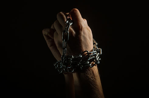 Hands are chained in chains isolated on