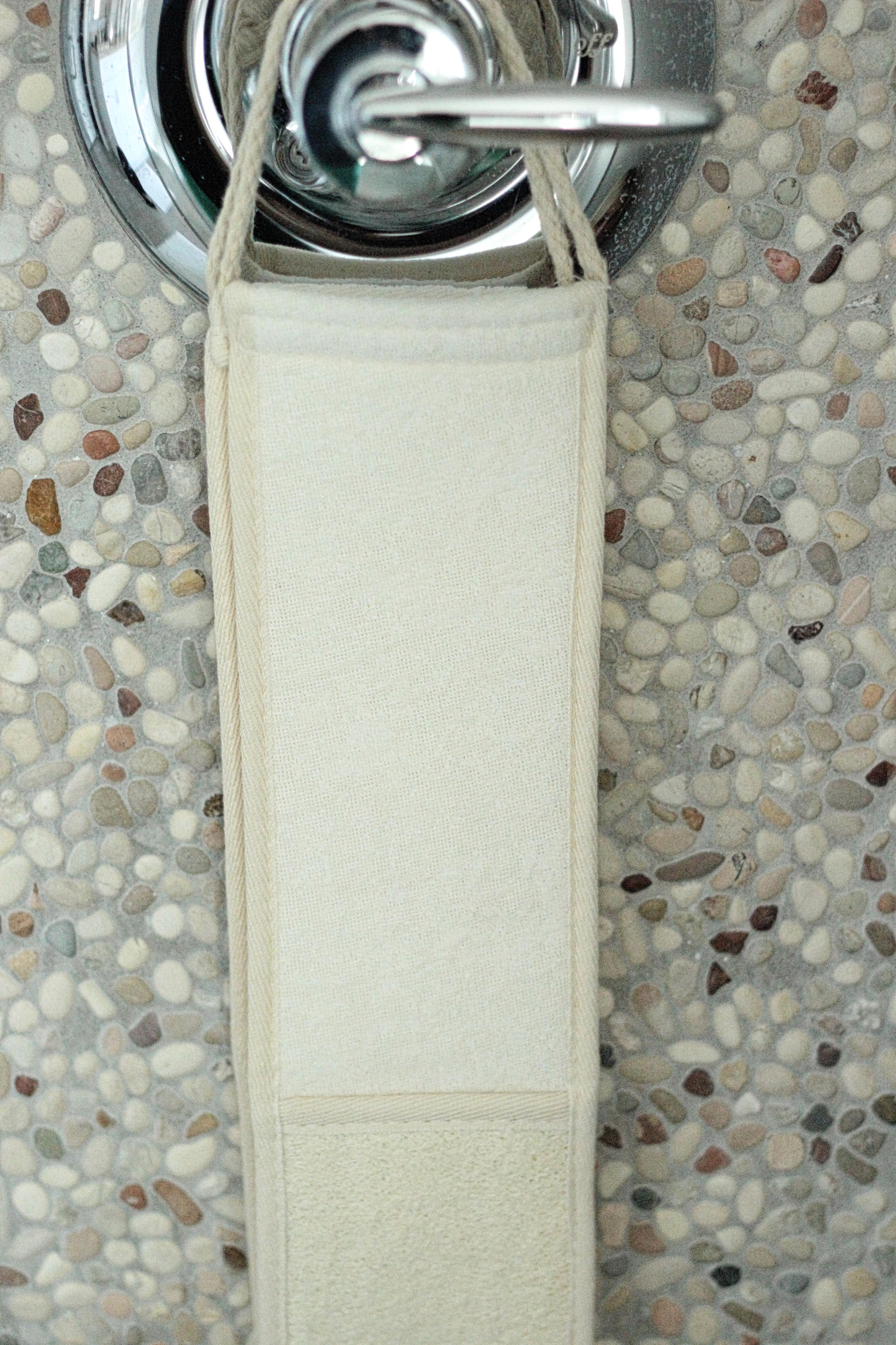 Luffa scrubber hanging in shower