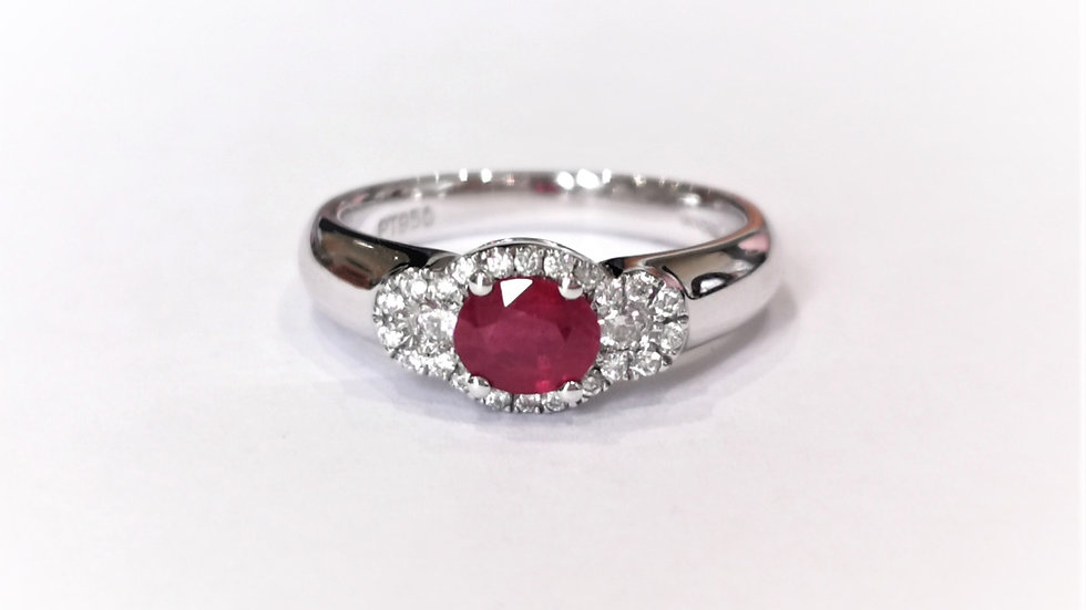 Platinum Ruby and Diamond Three Stone Halo Ring