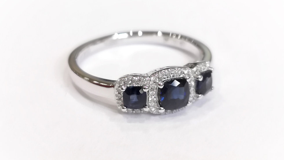 Platinum Sapphire and Diamond Three Stone Halo Ring