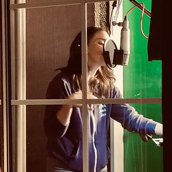 Sara Bareilles singing in the iso booth 2021