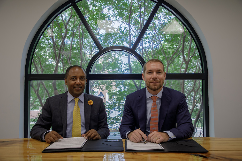 Zekarias Amsalu, Founder and Managing Director of IBEX Frontier LLC, and Leland Rice, CEO of Dedalus Global LLC, signing an MoU to jointly organize and execute the Africa Fintech Summit in Addis Ababa on November 21, 2019