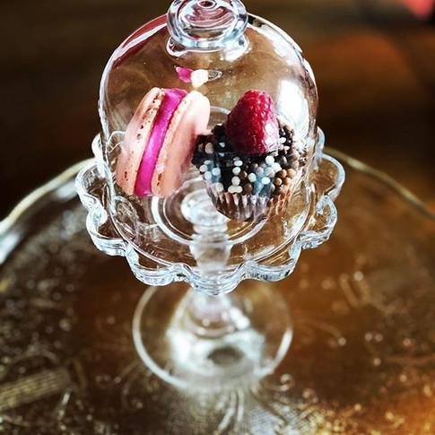 Raspberry macaron and mini cupcake.