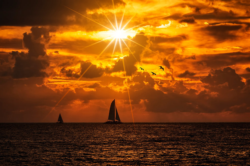 silhouetted-boat-sailing-along-its-journ
