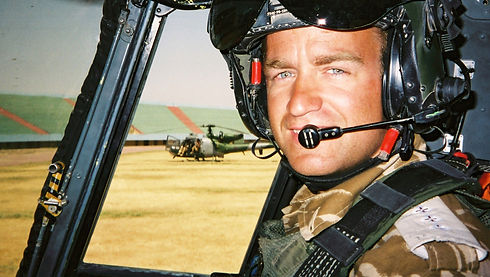 Military helicopter pilot sitting inside a Lynx Mk7