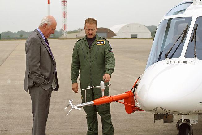 Helicopter test pilot Matt Ward explaining the functions of a Flight Test Air data boom