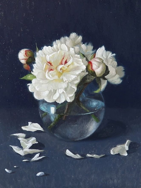 White peonies in glass bowl