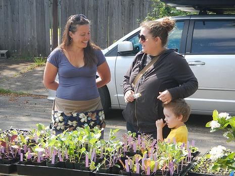 Marisha with a customer at a plant sale