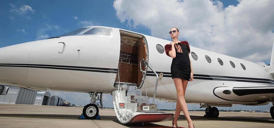 celebrity-walking-from-private-jet.jpg
