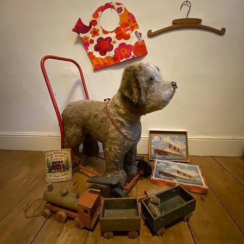 Vintage Straw Filled Push Along Dog