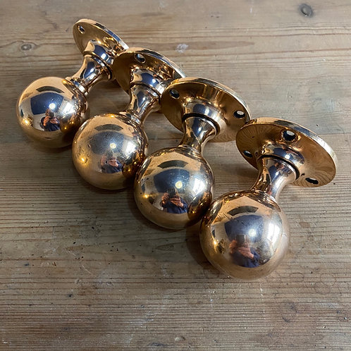 Two Pairs of Antique Brass Doorknobs