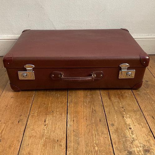 Vintage Maroon Globe Trotter Suitcase