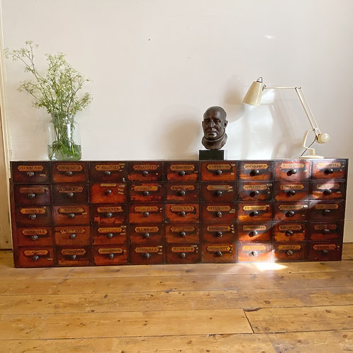 Bank of Early 19th C Apothecary Drawers