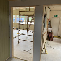 Doors to hall and kitchen