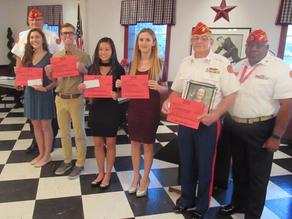 Marine Corps League Detachment presents scholarships to Villages High School students