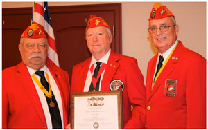 "(Above Center) ""James L. Davies, center, proudly displays The Chapel of Four Chaplains  Legion of Honor Humanitarian Award he received during Monday night's  meeting of the Col. Phillip C. DeLong Marine Corps League Detachment  1267. Davies was joined by Gene Lamont, left, of the Marine Corps League  of Inverness, and Orlando's John Gionet, who serves as the Department  of Florida Young Marines liaison officer."""