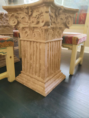 Columns holding up glass top