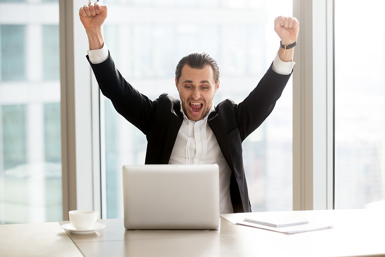 happy-businessman-in-front-of-laptop.jpg