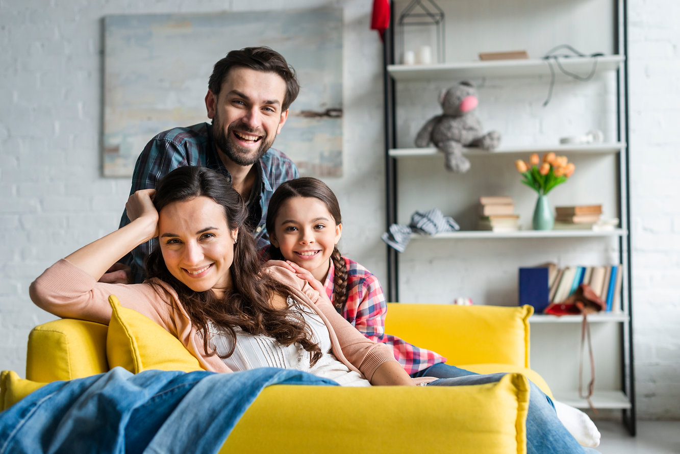 happy-family-sitting-on-couch-in-living-