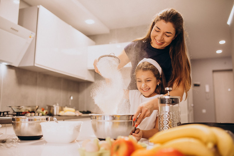 mother-with-daughter-baking-at-kitchen-t