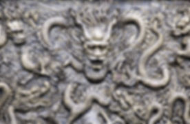Ancient bronze dragons carving in the an
