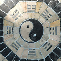 yin yang symbol on tiled wall.jpg
