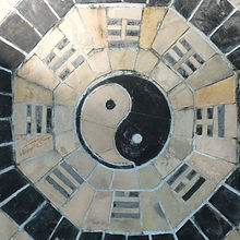 yin yang symbol on tiled wall.jpg