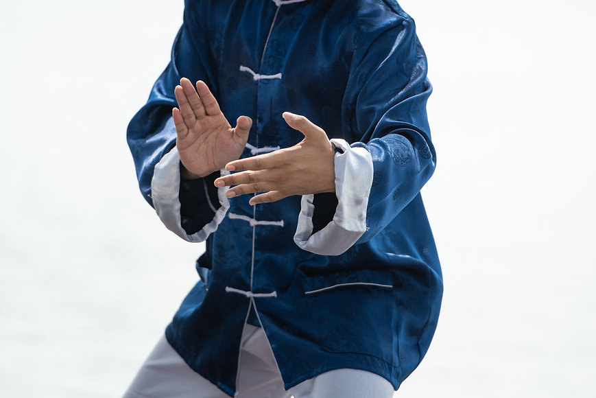 Close up of man hands doing Tai Chi or T