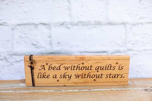 "4300 - 10"" Sign, ""A bed without quilts..."