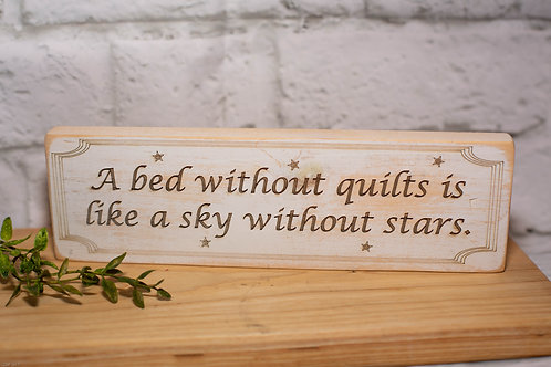 "4100 - 10"" Sign, ""A bed without quilts..."""
