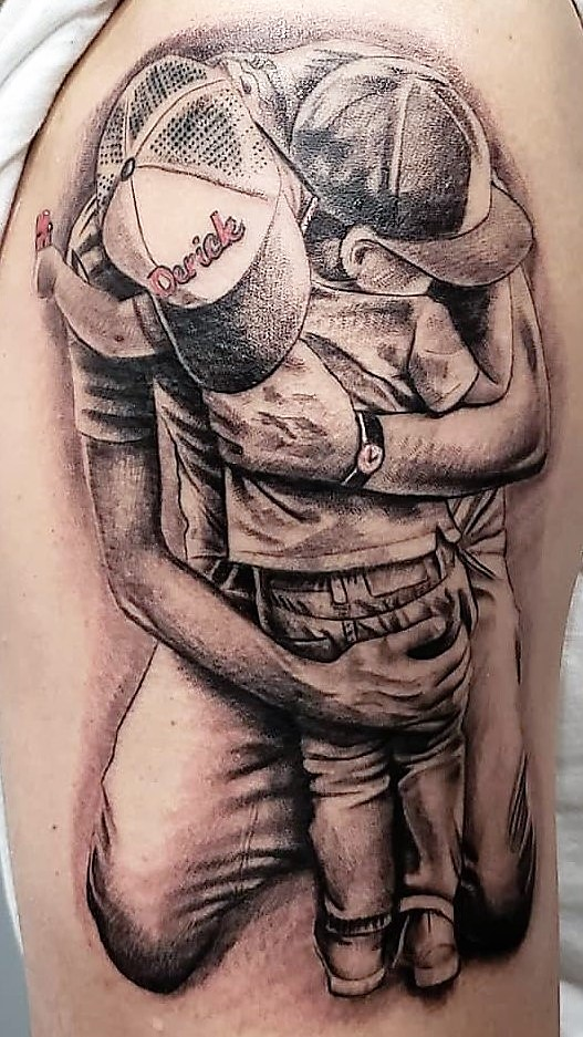 black _ Grey dad hugging son.jpg