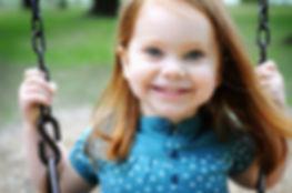 Girl on Swing- redhair.jpg