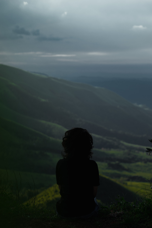Girl sitting on a serene hilltop