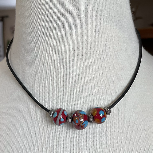 Lamp work beads with leather choker